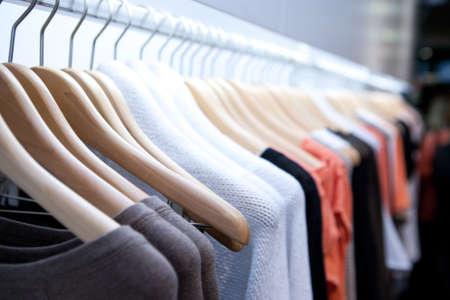 Photo pour Clothes hang on a shelf in a designer clothes store in Melbourne, Australia - image libre de droit