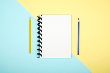 Photo for Top view of open spiral blank notebook on colorful desk background - Royalty Free Image