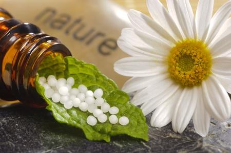 Foto de  alternative medicine with homeopathy and globules - Imagen libre de derechos