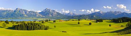Foto de wide panorama landscape in Bavaria, Germany, with alps mountains - Imagen libre de derechos