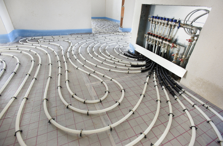 Foto de underfloor heating in construction of new residential house - Imagen libre de derechos