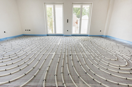 Photo for underfloor heating in construction of new residential house - Royalty Free Image