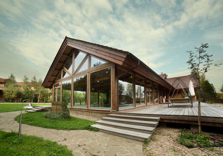Photo for luxury wooden house with trees and swimming pool - Royalty Free Image