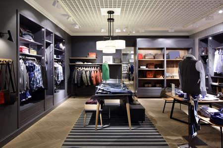 Foto de luxury and fashionable brend new interior of cloth store - Imagen libre de derechos