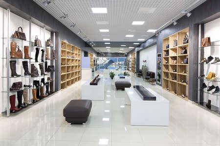 Foto de bright and fashionable interior of shoe store in modern mall - Imagen libre de derechos
