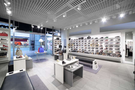 Foto de bright and fashionable interior of shoe store in modern mall - Imagen libre de derechos