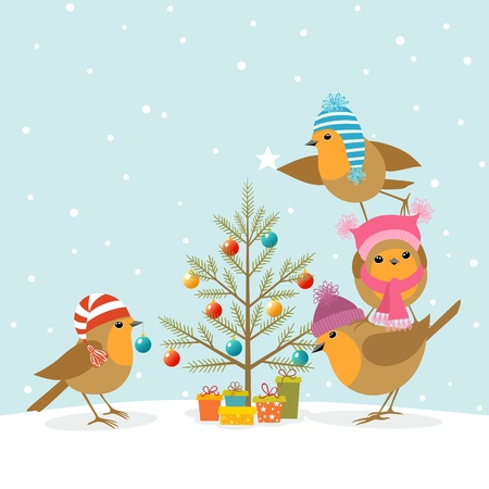 Funny Robins decorating a Christmas tree.