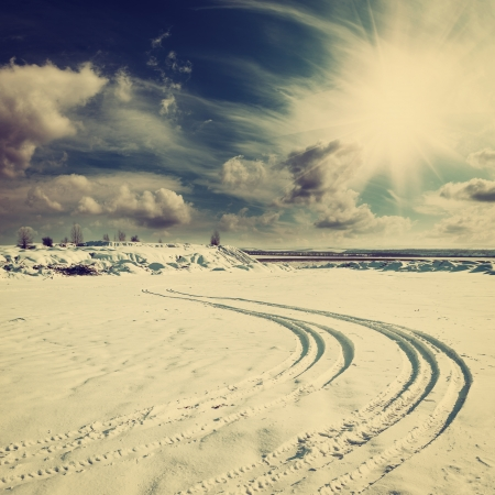 Photo for Vintage winter landscape with tire trace on snow - Royalty Free Image