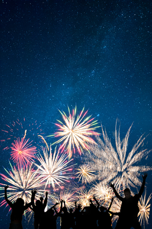 Photo for Friends looks holiday fireworks, for Christmas and New Year design, background and banner - Royalty Free Image