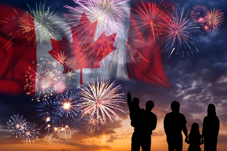 Foto de People looks holiday fireworks on independence day, flag of Canada in sky, background and banner - Imagen libre de derechos