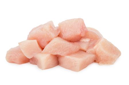 Foto de Pieces of raw chicken meat isolated on white background - Imagen libre de derechos
