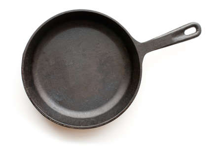 Cast-iron frying pan isolated on white background with shadow