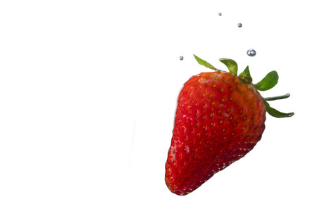 Photo for Ripe strawberry on white background submerged in water with bubbles - Royalty Free Image