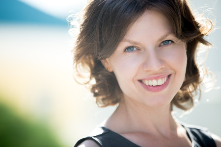 Photo for Headshot portrait of happy beautiful caucasian woman on the street in summer, friendly smiling, looking at camera with cheerful confident expression - Royalty Free Image