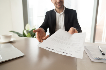 Photo pour Recruitment manager reaching out sheet with employment agreement. Smiling CEO offers to read and check work conditions, invites to sign document. Getting new job, hiring negotiations concept. Close up - image libre de droit