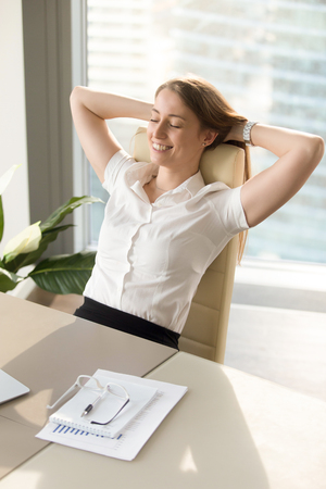 Photo for Positive smiling woman relaxing in office chair, happy businesswoman enjoys break, gets inspiration while meditating at workplace, feels relaxed at work desk by closing eyes, holds hands behind head - Royalty Free Image