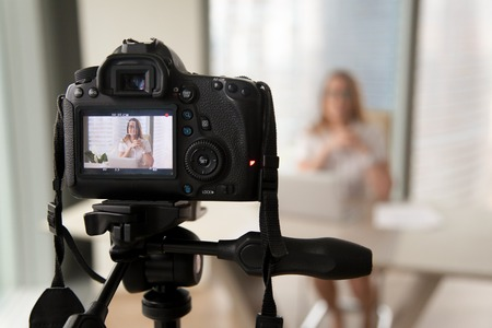 Photo for Professional digital equipment recording video blog of businesswoman, online business coach making presentation for website, filming popular vlog or master class for videoblog channel, focus on camera - Royalty Free Image