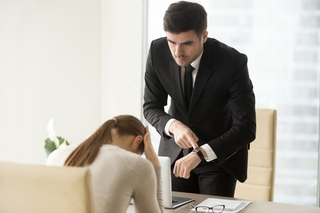 Photo pour Upset woman being scolded by boss for coming late at office, frustrated manager feeling guilty because of missed deadline while receiving reprimand, ceo scolding unpunctual employee after bad work - image libre de droit
