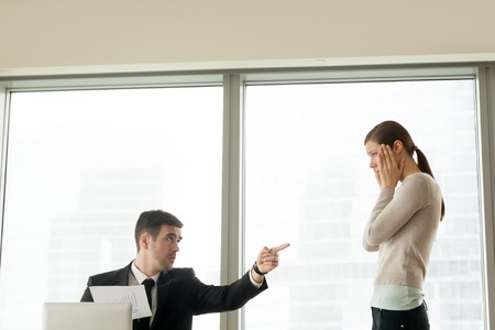 Photo for Bad ceo firing incompetent intern for poor performance result, angry boss dismissing ineffective employee, incompetence as reason to get fired from job, gender discrimination at work, copy space - Royalty Free Image