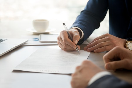 Photo for Close up image of businessman hand putting personal signature on contract document in presence of business partner. Starting successful partnership with entrepreneur or companie, making good deal - Royalty Free Image