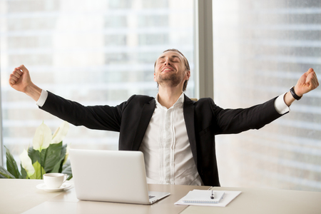 Photo for Smiling happy businessman raising arms up celebrating finished work project at workplace. Financial success, business interview successfully done, closing important deal, great stock news concept. - Royalty Free Image