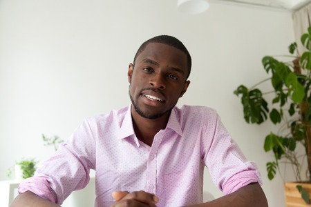 Photo for African-american man talking looking at camera, black man vacancy candidate making video call for distance job interview, dark-skinned vlogger recording videoblog, view from webcam, headshot portrait - Royalty Free Image