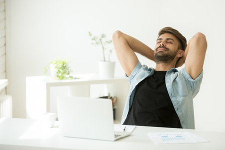 Photo for Relaxed young man resting from work on laptop holding hands behind head, successful entrepreneur relaxing feels happy breathing fresh air, smiling man enjoy break stretching in home office workplace - Royalty Free Image