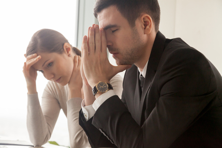 Photo for Stressed male and female business persons sitting at desk, hard thinking about problem. Businessman and businesswoman shocked, bad news, company bankruptcy, mistake in work, big reduction in office - Royalty Free Image