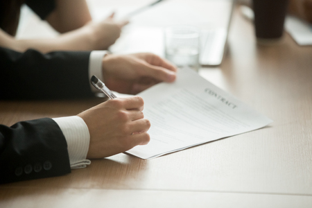 Photo for Businessman in suit signing business contract making deal, investor or executive putting signature on commercial paper, filling legal document in lawyers office, taking loan insurance, close up view - Royalty Free Image
