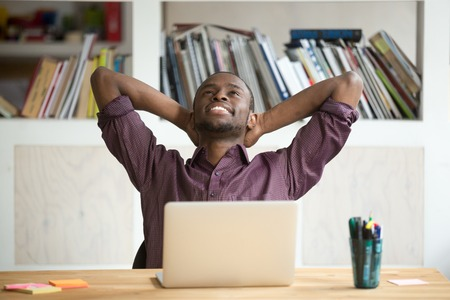 Photo pour Satisfied black worker relaxing leaning in comfortable chair with hands overhead happy with finished work, successful business report and promising results. Concept of rewarding, resting and winning - image libre de droit