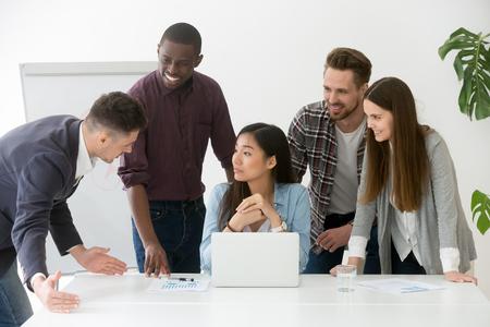 Foto de Creative business group having discussion at office meeting asking asian team leader questions - Imagen libre de derechos
