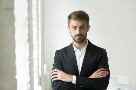 Photo for Headshot portrait of confident young caucasian businessman standing looking at camera, posing for commercial company photoshoot with arms crossed. Concept of leadership, success, ambition - Royalty Free Image