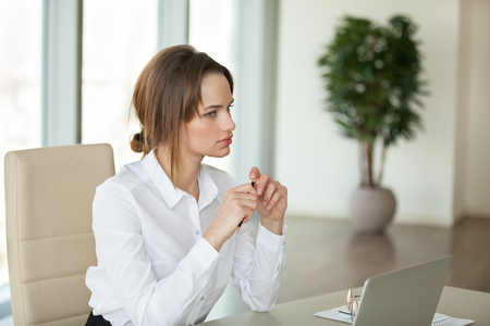 Photo for Focused female boss looking in distance thinking about business projects, planning new startups, thoughtful businesswoman considering company risks and opportunities, searching for problem solution - Royalty Free Image