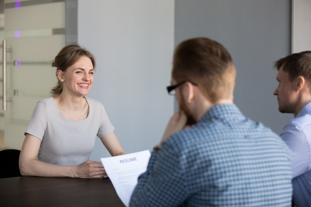 Photo for Smiling candidate making good first impression during interview, confident applicant laughing when talking to HR manager hiring her, worried or nervous woman applying for open job vacancy in office. - Royalty Free Image