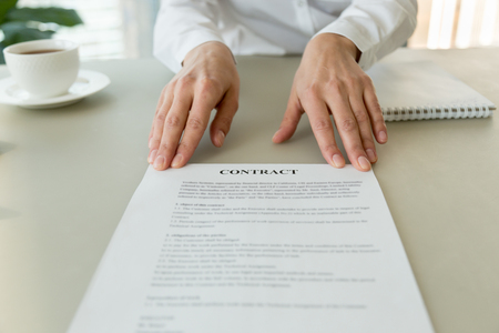Photo pour Woman offering business contract at camera for signing or reading terms concept, promising good partnership deal, proposing new job employment agreement, deal for bank loan insurance, close up view - image libre de droit