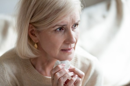 Foto de Sad frustrated mature old woman in tears feeling blue thinking of loneliness sorrow grief, upset thoughtful middle aged woman crying worried about problems, depressed senior widow mourning grieving - Imagen libre de derechos