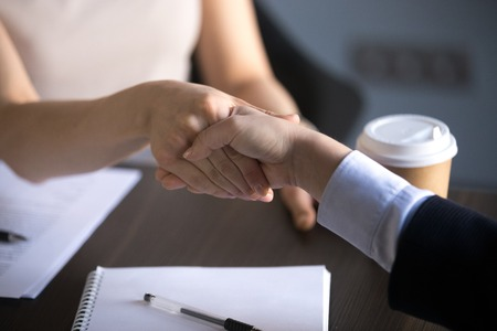 Photo for Hands of business women shaking making good partnership deal, women handshaking as concept of respect, successful teamwork, collaboration and support, women power in business, close up view - Royalty Free Image