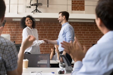 Photo for Happy ceo and team congratulating successful african american worker by shaking clapping hands, smiling black employee excited by reward bonus promotion, handshake as gratitude recognition concept - Royalty Free Image
