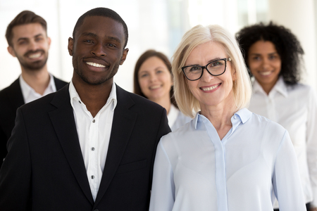 Photo for Diverse old and young professional business coaches or corporate leaders with team people portrait, smiling multiracial executive partners, african caucasian company staff group looking at camera - Royalty Free Image