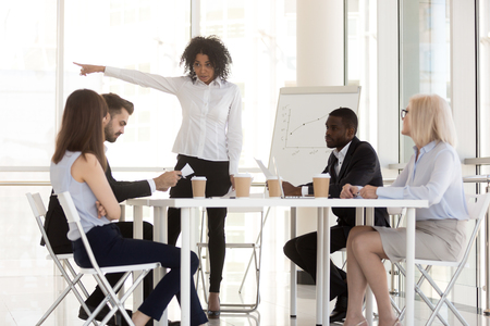 Photo for Angry mixed race manager team leader firing incompetent employee intern for bad results asking to leave group office meeting having conflict or dispute, racial discrimination at work concept - Royalty Free Image