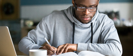 Photo pour Closeup smart millennial african student wear glasses hold pen noting writing down information study use book preparing for university or college test exam, horizontal photo banner for website header - image libre de droit