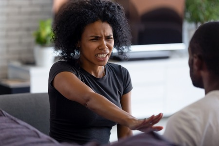 Foto de Abused angry scared african wife victim shows stop enough violence hand gesture, unhappy black woman afraid of fight with husband feels desperate about aggression, bad relationships, family conflict - Imagen libre de derechos