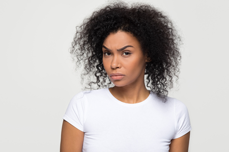 Foto de Suspicious annoyed young african american woman with distrustful face looking at camera, skeptical sarcastic black girl feeling cautious dubious distrusting isolated on grey white studio background - Imagen libre de derechos