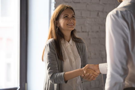 Photo for Businessman shake hand of excited female employee greeting with job promotion or employment, male boss handshake happy young woman worker congratulating with success or achievement in office - Royalty Free Image