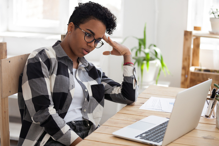 Photo for Bored african woman tired from computer work study online feeling dull at workplace, unmotivated black young woman student disinterested in monotonous job routine, lack of new ideas or motivation - Royalty Free Image
