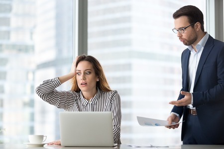 Photo for Angry boss scolding terrified stressed lazy female worker for bad work, shocked confused incompetent silly secretary forgot missed deadline worried about mistake in financial report or duties failure - Royalty Free Image