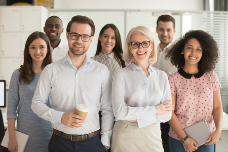 Photo for Smiling professional business coaches leaders mentors posing together with diverse office workers interns group, happy multicultural staff corporate employees people looking at camera, team portrait - Royalty Free Image