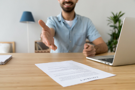 Photo for Close up businessman extending hand for handshake, offer to sign contract to client, customer, smiling friendly employee, agent making great deal, congratulating partner with agreement - Royalty Free Image