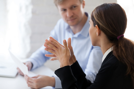 Photo pour Two business people new employee and employer having dialogue. Man from human resource management interviewing lady, negotiation, recruiting, consulting, sale broker negotiating with client. Side view - image libre de droit
