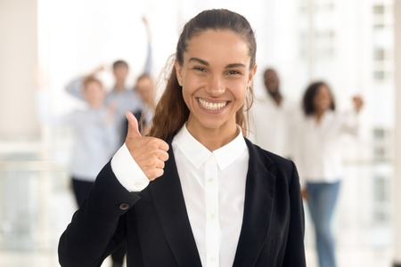 Photo for Happy young business woman manager and team people showing thumbs up as good service satisfied client concept, smiling customer hr raise finger looking at camera recommend best choice, portrait - Royalty Free Image